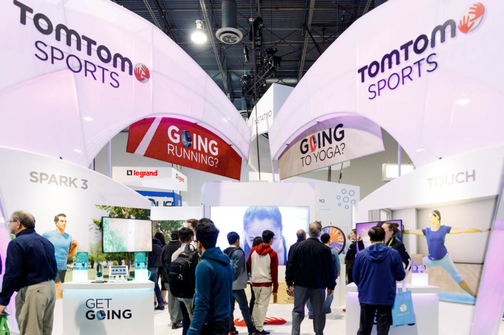TomTom Sports booth, TomTom Sports, Living In Digital Times, CES, Convention, Conference, Marketing, Promotional Material, engage, interviews, demos, show floor, booths, attendees, exhibitors, CES 2017, 2017, Corporate Photo, Photo Editing, Post-Production, Recap, Adobe Premiere, Editing, Photographer, Photographers in Las Vegas, professional Photography, High Tech Retailing, Video Production, Corporate Video, Video Editing, Post-Production, Recap, Adobe Premiere, Editing, Best Published Las Vegas Videographer, Videographer, Videographers in Las Vegas, Video production crew, Camera operators, Videography, professional Videography, attendees walking,