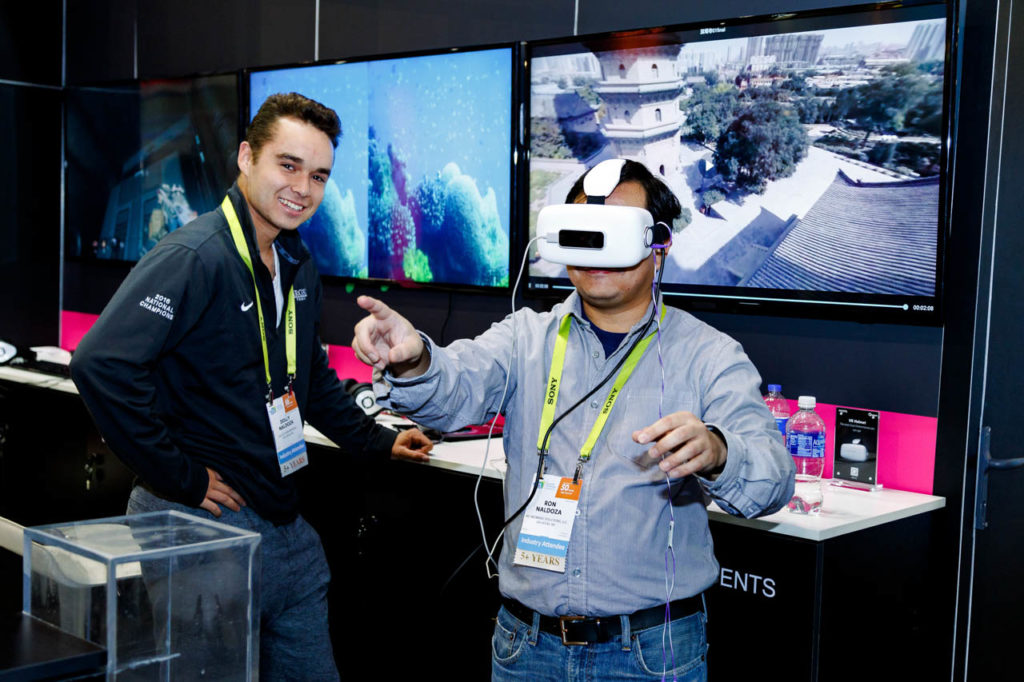 VR Goggles, Video Production, Corporate Video, Video Editing, Post-Production, Recap, Adobe Premiere, Editing, Best Published Las Vegas Videographer, Videographer, Videographers in Las Vegas, Video production crew, Camera operators, Videography, professional Videography, High Tech Retailing, Living In Digital Times, CES, Convention, Conference, Marketing, Promotional Material, engage, interviews, demos, showfloor, booths, attendees, exhibitors, Las Vegas Video Production, Las Vegas Convention Center, Video Production Las Vegas, Las Vegas, Nevada, Video Production set up, Sands Expo, Corporate Photo, Photo Editing, Post-Production, Recap, Adobe Premiere, Editing, Photographer, Photographers in Las Vegas, professional Photography, product demo, live demo, demonstration,